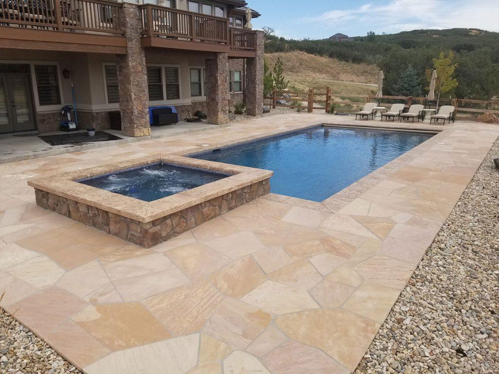 denver lanscaping companies building pool decking for backyard